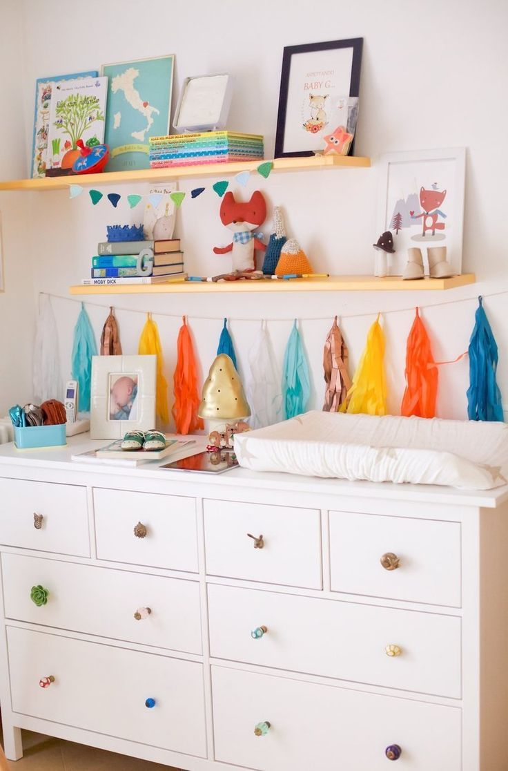 A variety of knobs adds some fun and this colorful tassel is an affordable way to decorate in Baby G's Bright, Playful Space