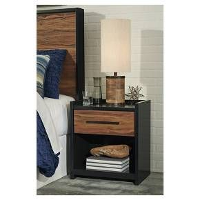 Ultra-modern and clean lined, This nightstand is a mastery in the art of simplicity. Unique two-tone treatment blends a rich, replicated cherry finish with contrasting black for urban industrial flair with an earthy sensibility. Signature Design by Ashley is a registered trademark of Ashley Furniture Industries, Inc.