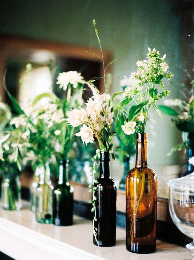 Brown Bottles filled with Flower Stems | Rise Hall in Yorkshire | English Country Garden Wedding | Illusion Back Annais Bridal 'Cecelia' Wedding Dress | Ashlee Taylor Barnes Photography | http://www.rockmywedding.co.uk/emma-james/