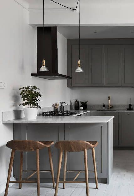 Grey kitchen with white marble worktops