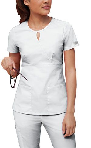 Dickies Keyhole Scrub Top in White  Original Junior Fit keyhole mock wrap top features an empire waist and bust darts. Patch pockets and side vents. Center back length: 25 1/2. Fabric: 65 Poly / 35 Cotton Poplin $11.99