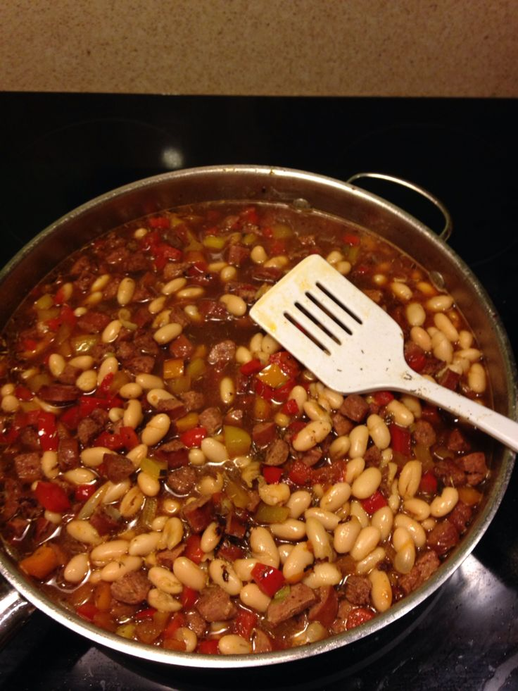 Turkey Sausage, Kale & White Bean One Pot Meal. 1-2 Turkey Sausages 2-4 cans Navy or Great Northern Beans (can use dried if you soak &precook) 1-2 cans diced tomatoes 1 each red, yellow, orange sweet bell pepper (or choose all one color or add in a green) 1/2-1 sweet onion or green onions Chicken stock (or water + bullion) Some minced garlic (your call) Salt & Pepper to taste Other spices to taste (you can go any direction from southwestern with cumin/chili powder to indian with a little…