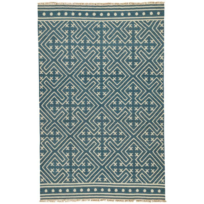 $330!! This global-inspired flatweave area rug boasts a captivating graphic pattern, recalling angular chinoiserie motifs. A modern twist on a traditional kilim style, this wool layer's deep blue and off-white design lends a classic colorway to on-trend spaces.