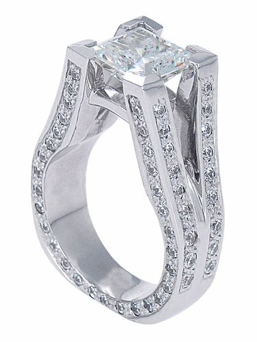 What a AWESOME wedding ring, for a cowgirl... A stir-up w/ a diamond resting, like a cherry on top. VERY NICE