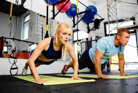 couple exercising floor exercises