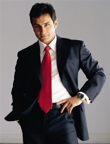 Saif Ali Khan (16 Aug)- Lined formal suit, white shirt and red tie- sophisticated!