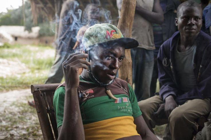A leader of an antibalaka militia group, Pelé, smokes a cigarette in the village of Balakadja, Central African Republic, on Aug. 4, 2015.