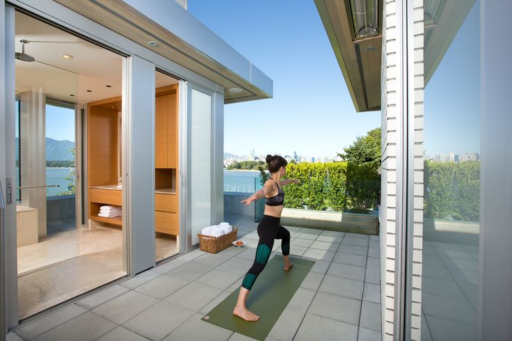 Yoga courtyard with a view. The glass wall in the shower opens for an indoor/outdoor experience.  By: Zacharko Yustin Architects Incorporated Photo: Ema Peter Photography