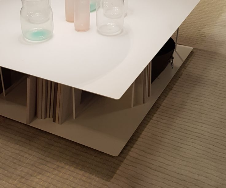A Fenix NTM coffee table in Bianco Kos (0032) with built-in bookshelf.
