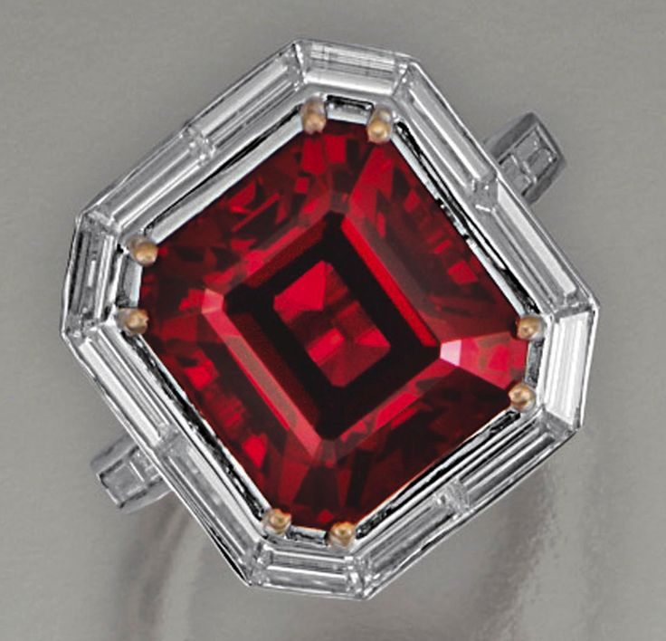 Spinel ring - The step-cut red spinel weighing 10.24 carats, set with a border of baguette diamonds, mounted in white gold, size 52.