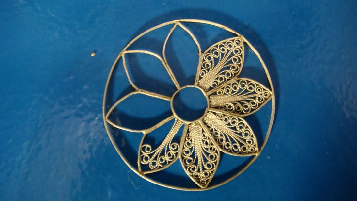 Creating one of our filigree pendants from Cathedral window series. The most time comsuming design - to date!