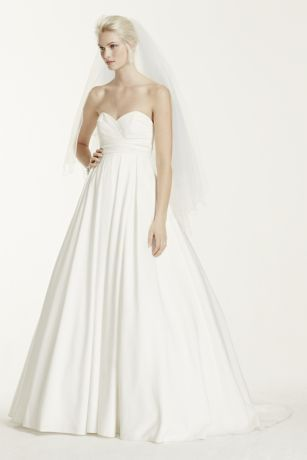 One of the many beautiful things about a wedding dress is that it's a perfect blank canvas for you to accessorize. This strapless faille ball gown with a sweetheart neckline, sweep train, and empire waist will inspire you to create a look that's all your own.   David's Bridal Collection.  Also available inPlus Size, Extra Length and Plus Size Extra Length. Check your local stores for availability.  Sweep train. Fully lined. Imported. Back zip with button detail. Dry Clean only.