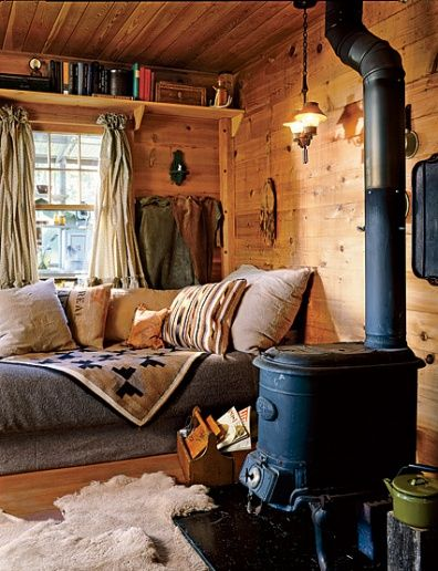 Featured in Architectural Digest, this potbelly stove and built-in bed at a cabin hideaway in Montana seems like the perfect respite from the busy modern world.