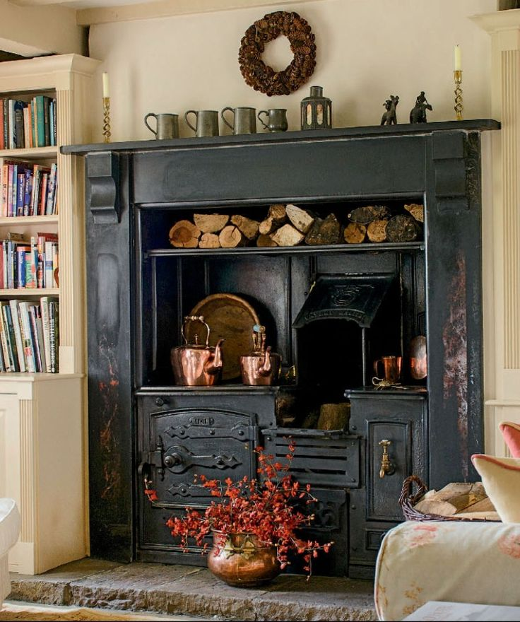 antique cast iron wood burning cook stove insert | interior design + decorating ideas