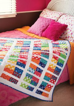 "Make this pretty, striped quilt in a snap using 5"" pre-cut squares in floral or geometric motifs."