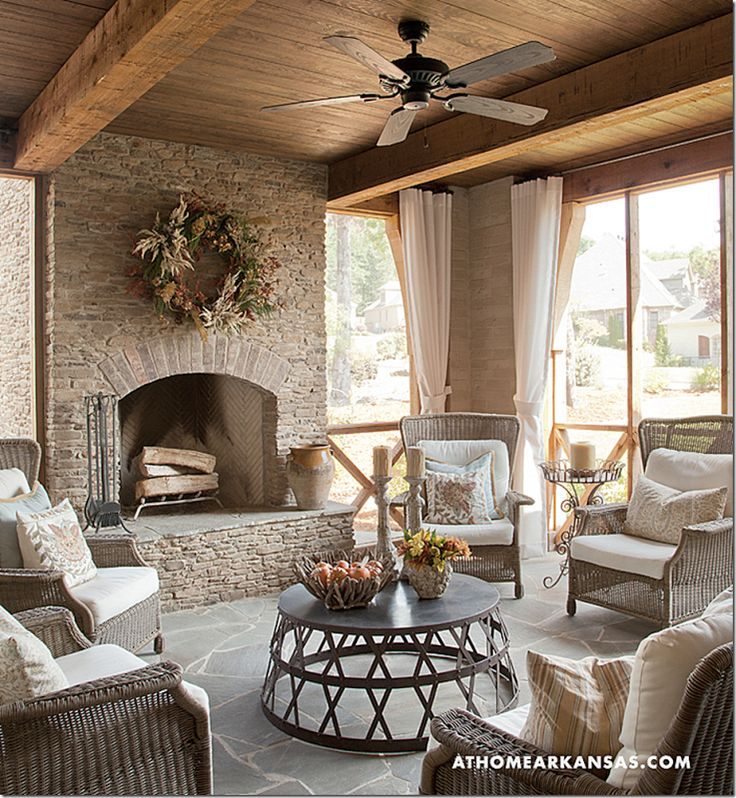 Pretty furniture and earthy color scheme for a screened in patio