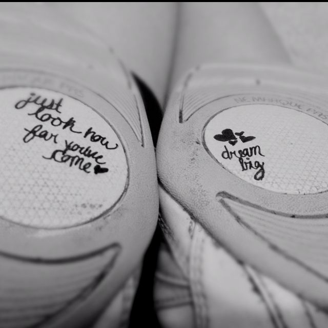 "Quotes on my cheer shoes. Cheerleading flyer inspiring bases ""dream big"" ""look how far you've come"""