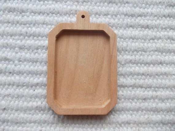 1pc unfinished rectangle shaped pendant base with round wooden hook and slightly cut corners,rectangle blank pendant/base bezel cup  wooden rectangle shaped pendant/brooch base for jewel making. In the centre of the pendant there is a rectangle-shaped cabochon frame/hole.  www.artwoodenstuff.com