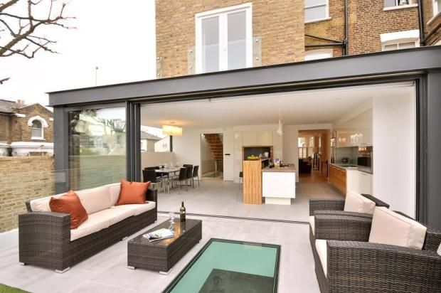 Exposed steel work and large sliding doors. 6 bedroom terraced house for sale in Ramsden Road, London, SW11, SW11