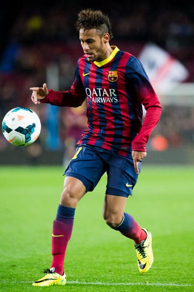 Neymar Santos Jr of FC Barcelona runs with the ball during the La Liga match between FC Barcelona and RC Celta de Vigo at Camp Nou on March 26, 2014 in Barcelona, Catalonia.