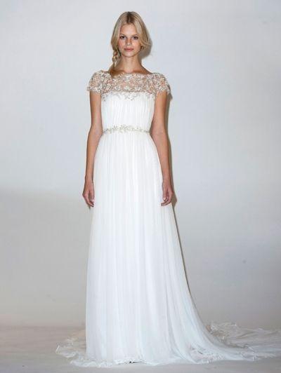 Witte trouwjurk met zilveren details en sleep - Ja, ik wil! De 20 mooiste trouwjurken van Bridal Fashion Week