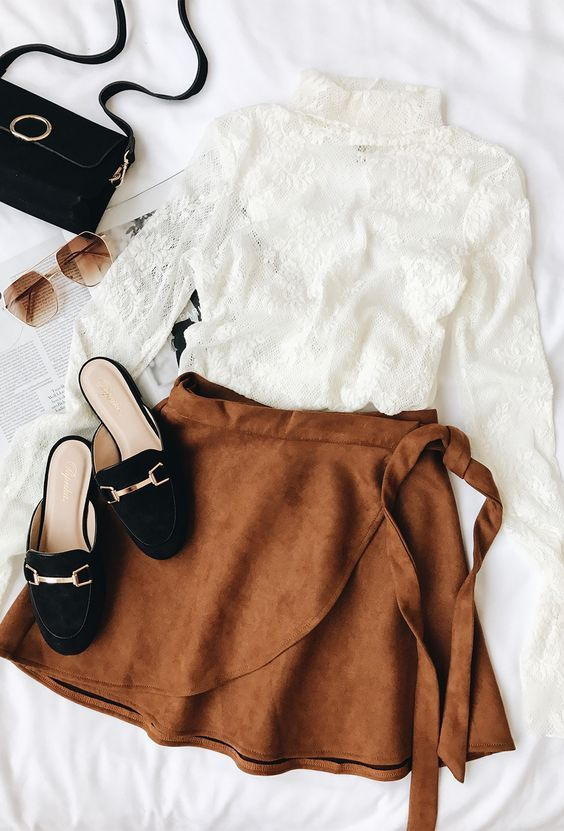Look chic in a snap with the Wrap to It Tan Suede Wrap Skirt! Soft and stretchy microfiber suede sweeps across this wrap skirt with a tying waist, skater silhouette, and mini length. #lovelulus #lulus #suedeskirt