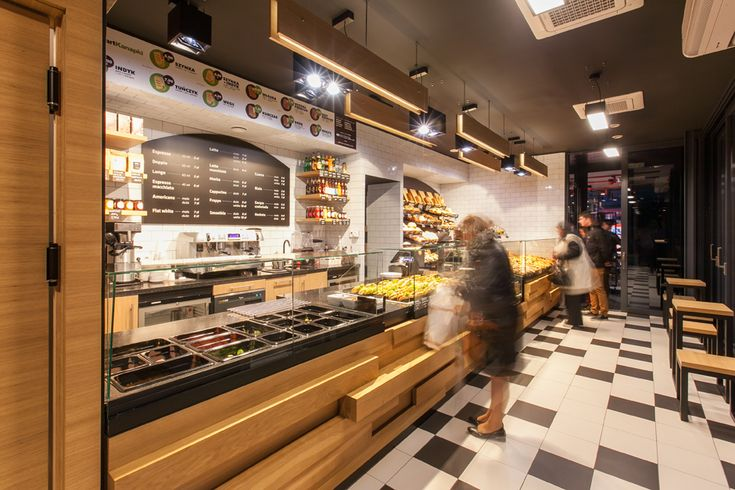 Creative polish bakery uses recycled baking trays as wall for Bakery interior design