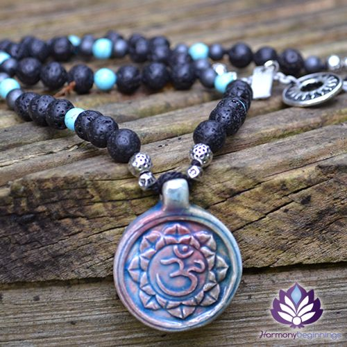 Our Unbounded Necklace has been designed with Lava Stone, accented with Turquoise and Hematite, and finished with a beautiful Om Raku Pendant from Peru. An amulet of grounding and protection, aiding the connection to the energies of Mother Earth and the element of Fire. Providing stability in times of change. This beautiful necklace is the perfect companion to our Unbounded Bracelet.