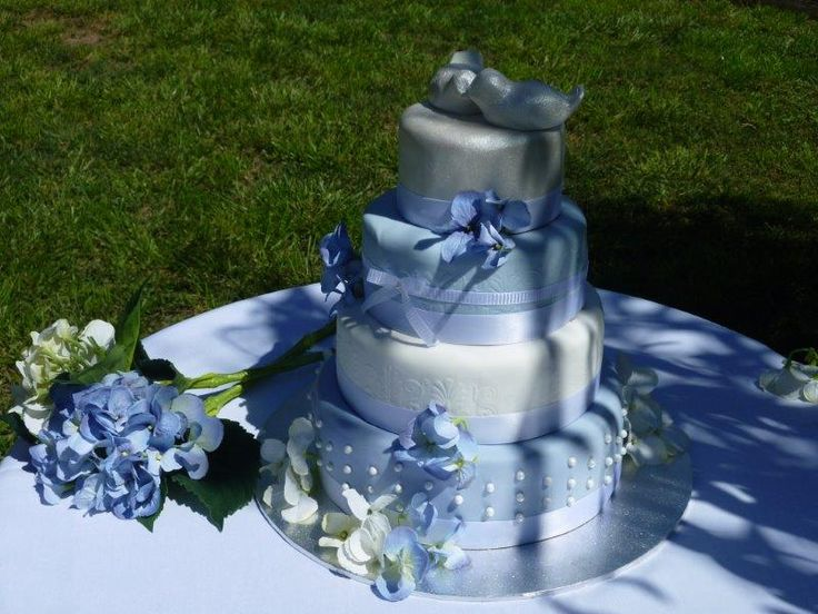 Pretty, four tiered wedding cake in alternating layers of chocolate mud and traditional fruit cake