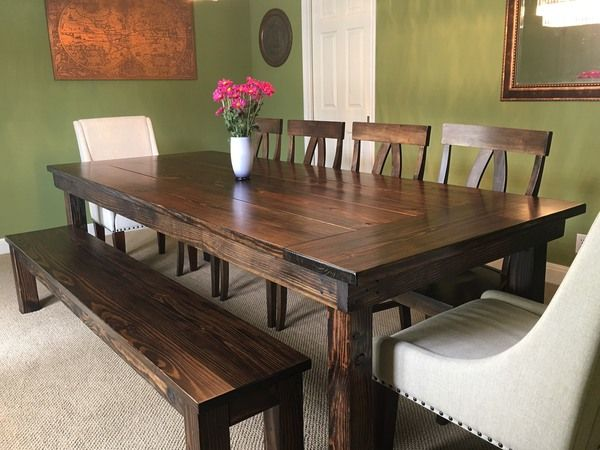 "8 5 L x 42"" W Farmhouse Table with a traditional top and endcaps in Dark Walnut stain Pictured with a matching Farmhouse Bench and Elizabeth Chairs"