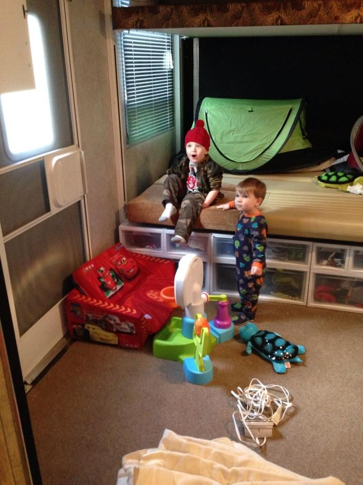 Plastic drawers for storage under the happi jac bed in a toy hauler