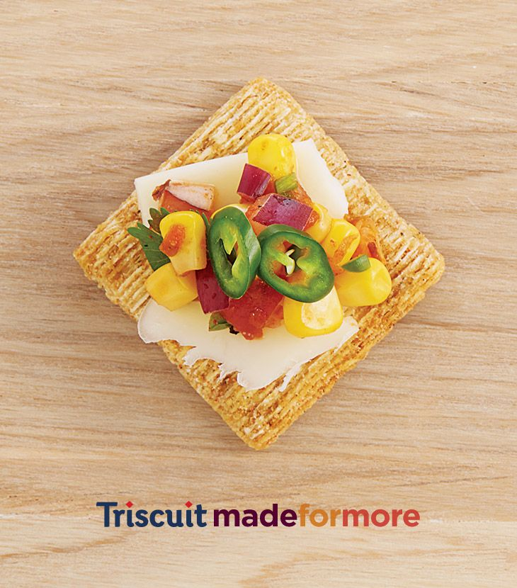 A zesty alternative to plain old chips and salsa. Layer corn salsa, chopped jalapeño, and a sprinkle of shredded Monterey Jack cheese on a Fire Roasted Tomato & Olive Oil Triscuit cracker. The jackpeñosalscuit - the perfect southwestern snack for high noon. Or regular noon.