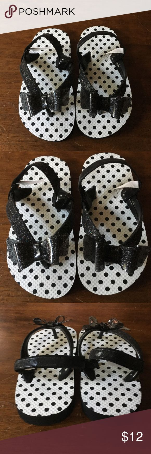 Toddler girl black and white glitter flip flops Toddler girl black and white glitter flip flops.  New without tags.  Never worn. Children's Place Shoes Sandals & Flip Flops