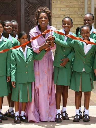 i admire all this woman has done...she has her critics but no one can deny how MUCH she has given to people...and as much as she has done i would bet there is a lot of wonderful things she has done anonymously...Oprah at the opening of her school for girls in South Africa