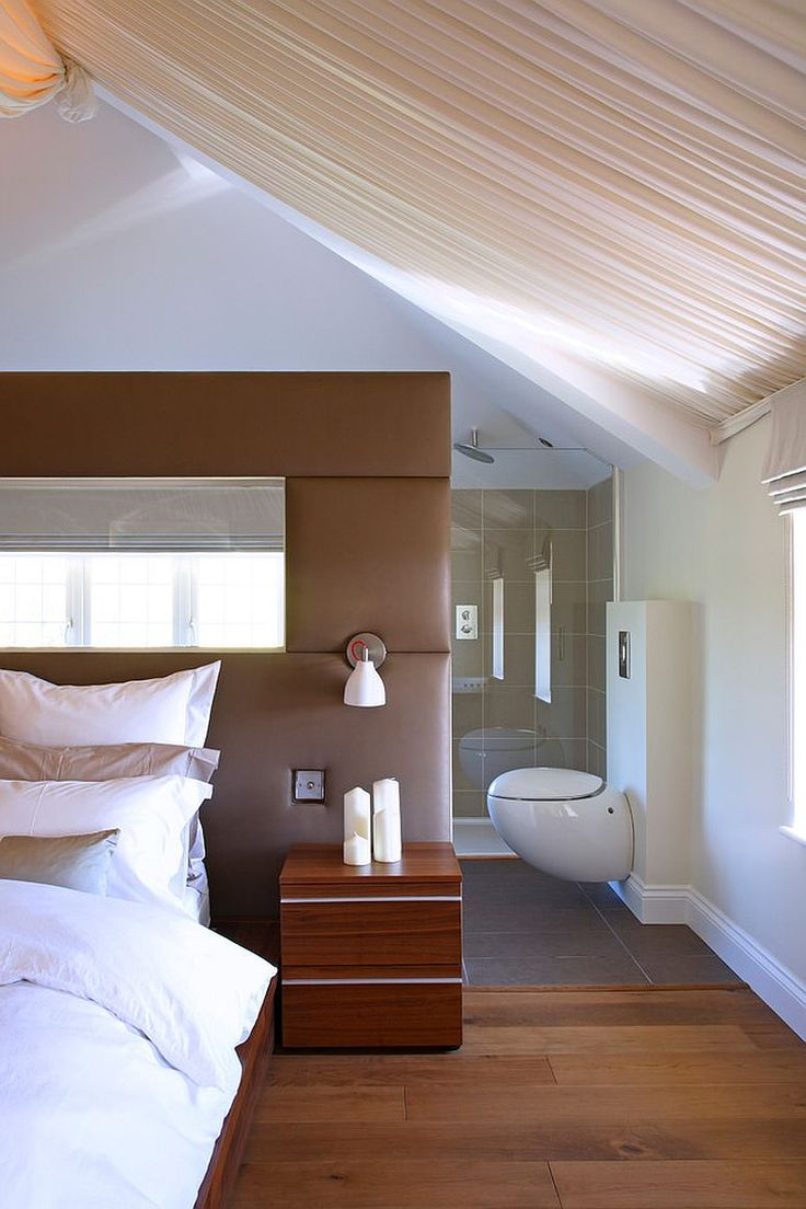 Plush headboard acts as a divider between the bedroom and the master bath [Design: Avocado Sweets Design Studio / Photography: Fisher Hart]