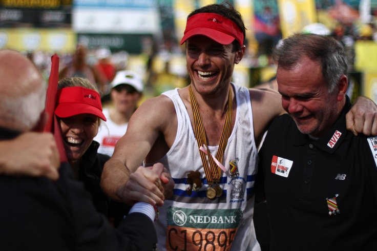With my dad, Miranda and Peter Proctor (Chairman of Comrades) at the finish line of Unogwaja 2012. It says it all