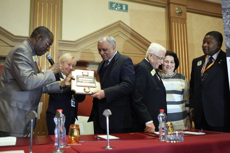 The President of the 18th All Africa gives the Melvin Jones Fellow plaque's to the Ambassador Joseph KOTANE.