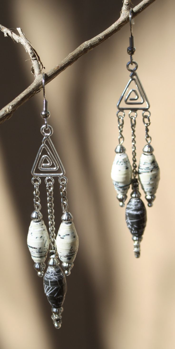 Using hand rolled, coated paper beads makes these long earrings light so they don't hurt your ears!