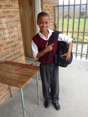 One little learner got a surprise today! Teaching volunteer, Jack Viljoen, left a backpack with stationary and goodies for him which our South African volunteer liaison in Knysna just dropped off for him. Look at that proud smile!