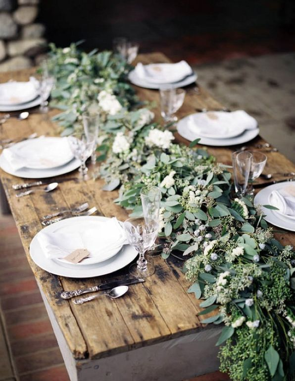 Evergreen centrepiece. Love this table runner comprised of eucalyptus. It could also be done with a base of greens.