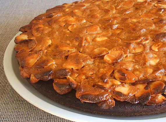Almond pie   Food From Portugal. A pie with excellent presentation, for the whole family, confectioned with flour, eggs, sugar, margarine and lemon zest, topped with a mixture of liquid caramel, condensed milk, whipping cream and almond kernels. http://www.foodfromportugal.com/almond-pie/