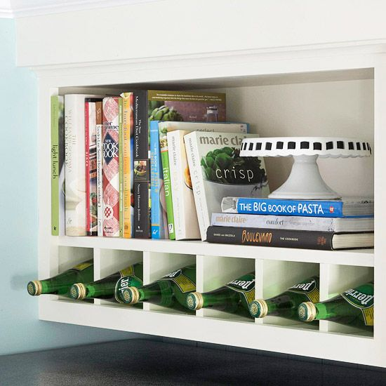 A little creativity yielded this savvy storage nook. By inserting dividers into this shelf, it went from one big space, to a built-in wine rack and cookbook shelf.