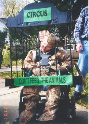 Homemade Circus Animal in a Cage Wheelchair Costume: We wanted Christopher's costume to coordinate with his sister's. We had decided that she was going to be a Circus Clown in a Clown in a Clown Car, so we