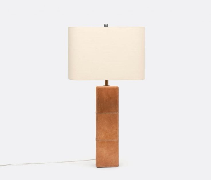 Made goods jude lamp is made of aged full grain camel leather covering the oversize column of this large lamp the tailored vibe of the jude has the look of