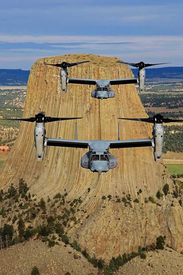 """A pair of U.S. Marine Corps Bell Boeing MV-22B Ospreys of the VMM-363 """"Red Lions"""" at Devils Tower, Wyoming. This photo by Ted Carlson was an honorable mention in the 2013 Vertical Photo Contest."""