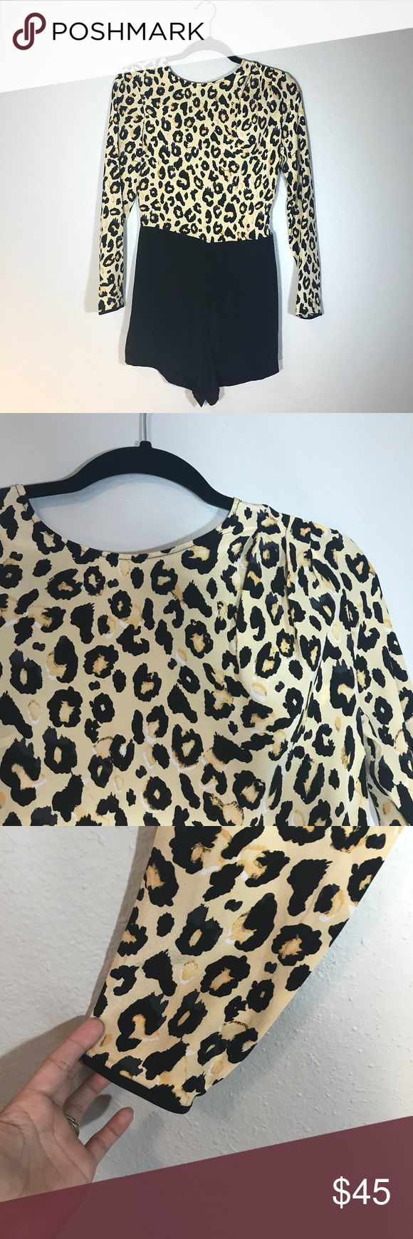 Dolce Vita Amazing Leopard Print Romper Amazing Romper by Dolce Vita. Top has an open back. Back zipper, black bottoms. Excellent condition. No fabric content tag but material is very soft. Not too casual. Dolce Vita Pants Jumpsuits & Rompers