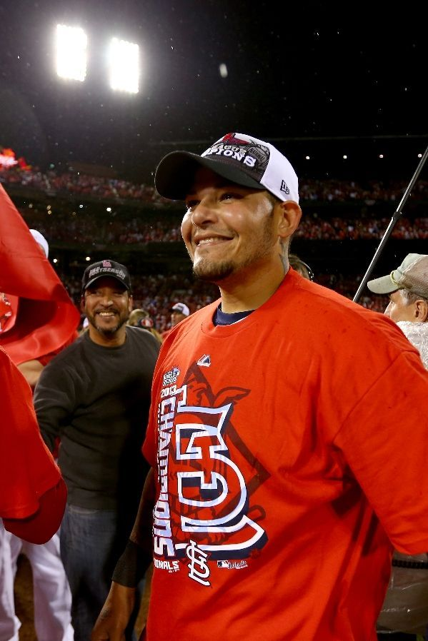Yadier Molina celebrates after the Cardinals defeat the Los Angeles Dodgers 9-0 in Game Six of the NLCS.  10-18-13