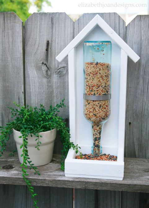Standing Bird Feeder: Wine is a great way to gather friends...and the empty bottles are a sweet way to gather birds.