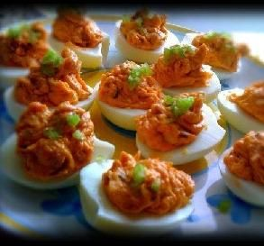 Buffalo Chicken Eggs: Deviled eggs are a favorite party appetizer, and these spicy staples are shaped like miniature footballs! Make sure to let them sit for 15 minutes before serving so the flavors can develop.