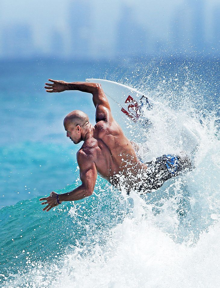 Slater at snapper, Photo by luke marsden (Look at Slater's shoulder & back muscles as he does a cut back - amazing)